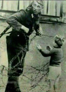 east german soldier helping boy